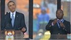 US President Barack Obama delivers a speech at the Nelson Mandela memorial next to sign language interpreter Thamsanqa Jantjie