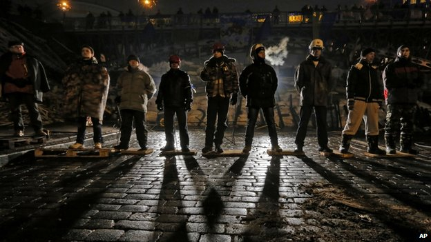 Pro-European Union activists guard barricades near the Independence Square in Kiev, Ukraine, early Friday, Dec. 13, 2013