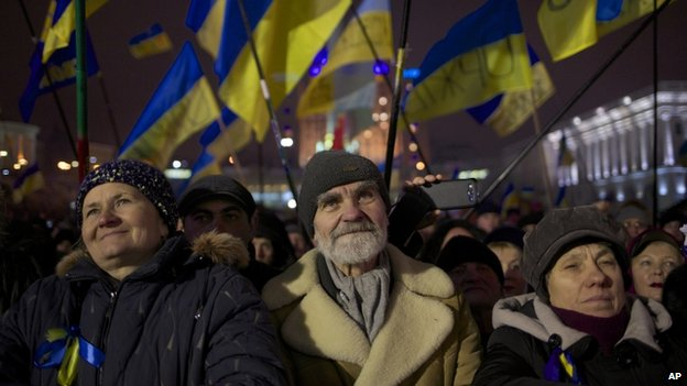 Pro-European Union activists wave Ukrainian national flags during a rally in Independence Square in Kiev, Ukraine, Thursday, Dec. 12, 2013