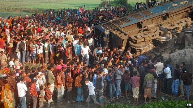 Bangladeshi onlookers gather at the scene of a derailed train in Gaibandha, some 200 kms north from Dhaka, on December 4, 2013