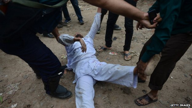 Bangladesh police detain a Jamaat-e-Islami activist during a protest in Dhaka on February 12, 2013