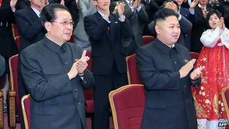 File photo: Chang Song-thaek (left) and North Korean leader Kim Jong-un (right) at the People's Theatre in Pyongyang, 15 April 2013