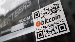 A sign saying Bitcoin