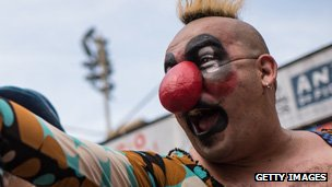 A clown laughing