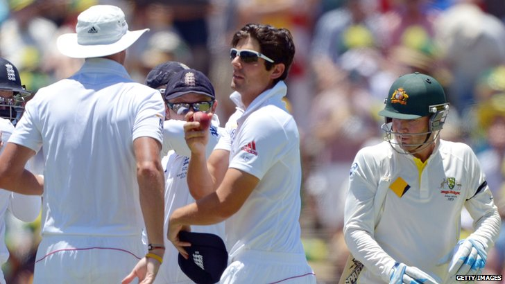 Michael Clarke (right) walks off after being caught by Alastair Cook (centre)