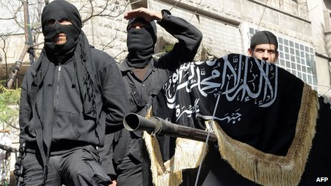 Al-Nusra Front taking part in a parade in Aleppo. Oct 2013