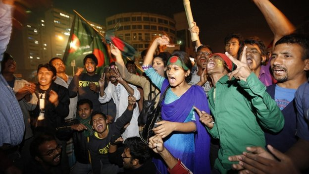 "People celebrate after hearing the news of Bangladesh Jamaat-E-Islami leader Abdul Quader Mollah""s execution in Dhaka December 12, 2013."
