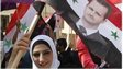 Woman with flag and portrait of Bashar al-Assad (file photo)
