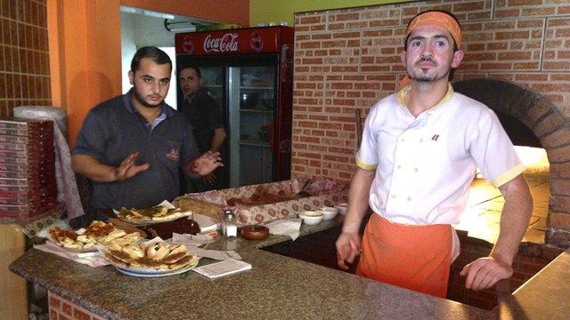 Hamza Issa (left) with Syrian chef