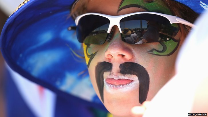 A fan with a painted-on Mitchell Johnson moustache