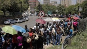 People wanting to pay their respects to Nelson Mandela queue in dowtown Pretoria