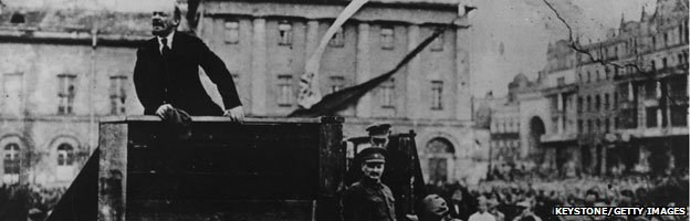 Lenin addresses a huge crowd in Sverdlov Square Moscow with Leon Trotsky to the right of the podium