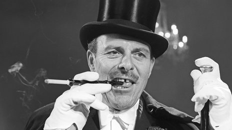 Terry Thomas in top hat and white gloves