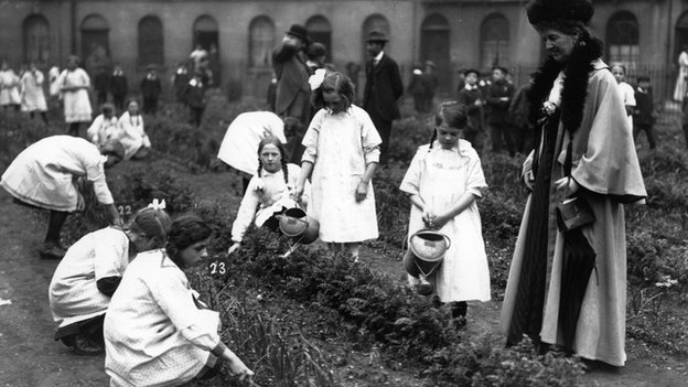 The Duchess of Montrose visiting  a group of child gardeners in 1914.
