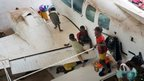 Children play on a light aircraft in a camp for internally displaced people, set up in Bangui airport, Central African Republic, 13 December