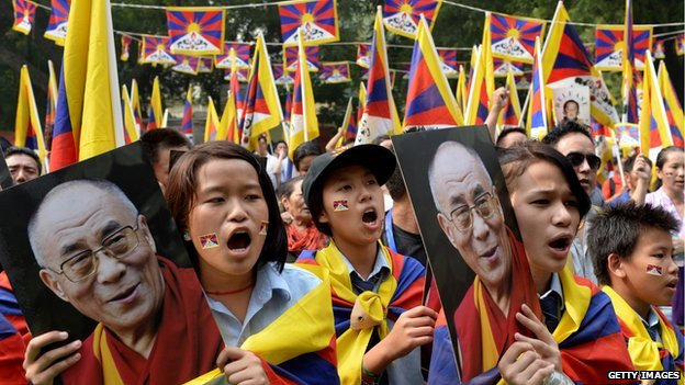 Tibetans in exile hold a picture of the Dalai Lama during a protest in New Delhi this year