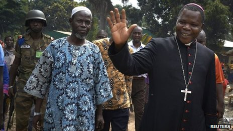 Dieudonne Nzapalainga (R), archbishop of Bangui and Imam Oumar Kobine Layama, president of the Islamic Central African community in Bangui, CAR (13 Dec 2013)