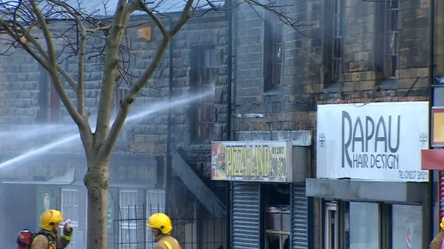 Water being sprayed at buildings