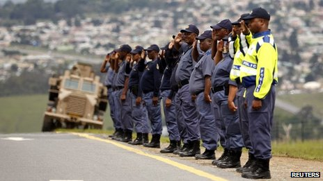 Police officers line the road in Mthatha, in the Eastern Cape, as part of a rehearsal for Nelson Mandela's funeral