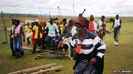 A Xhosa woman sings and dances as young men take part in a manhood ceremony in Qunu ahead of Nelson Mandela's funeral on Sunday