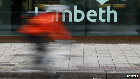 A cyclist passes a Lambeth sign on a council building in south London