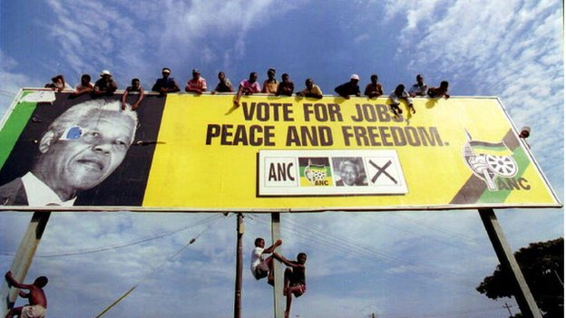 African National Congress (ANC) supporters wait for Nelson Mandela on a billboard in a township just outside Durban before for a pre-election rally in KwaZulu-Natal in 1994