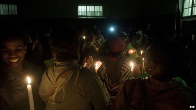 People light candles during a visit at Robben Island, off Cape Town, for an all night vigil to commemorate Nelson Mandela. Photo: 13 December 2013