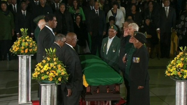 Mourners stand around the coffin of late former South African President Nelson Mandela during a send-off ceremony at Waterkloof Air Force base in Pretoria