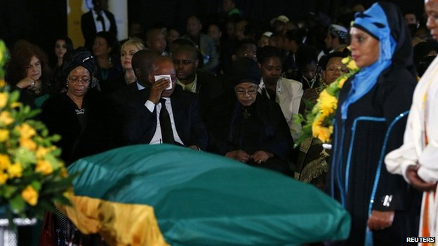 President Zuma flanked by Graca Machel (L) and Mandela's ex-wife Winnie Mandela