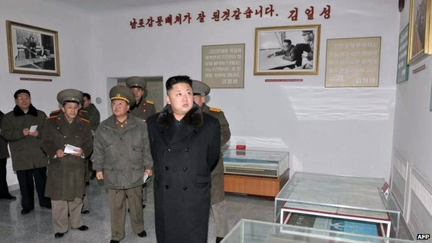 This undated picture released by North Korea's official Korean Central News Agency (KCNA) on 14 December 2013 shows North Korean leader Kim Jong-Un (C) inspecting a military design institute at an undisclosed location in North Korea
