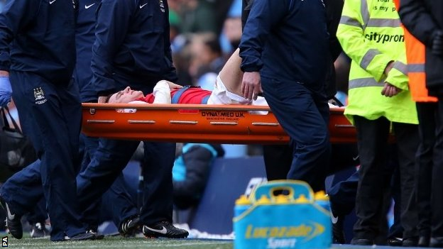 Arsenal's Laurent Koscielny is stretchered off