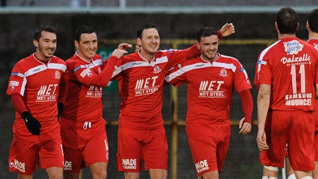 Portadown players celebrate their second goal against Coleraine at Shamrock Park
