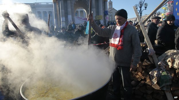 Pro-European Union activists cook food during a rally in Independence Square in Kiev, Ukraine (Dec. 14, 2013)