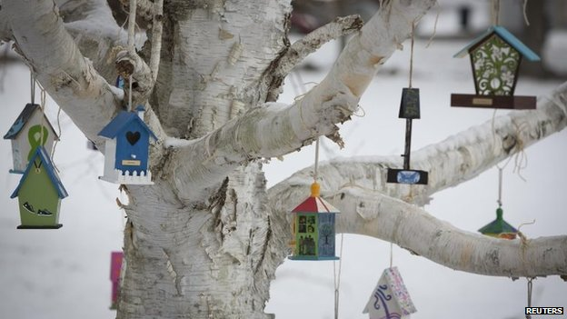 A tree is hung with birdhouses bearing the name of Sandy Hook Elementary School shooting victims as part of a memorial in Sandy Hook village in Newtown, Connecticut December 13, 2013.