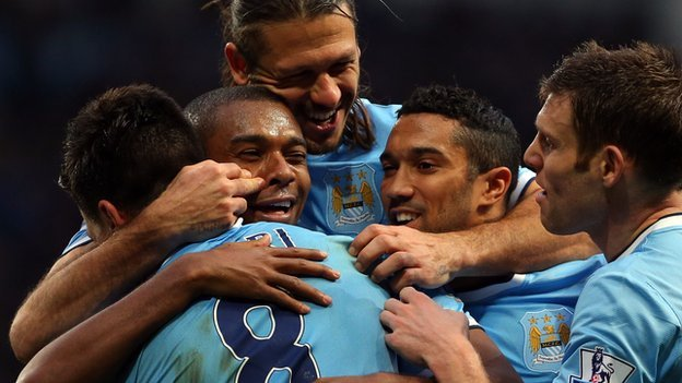 Manchester City players celebrate during win over Arsenal