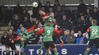 Crusaders captain Colin Coates rises highest to head clear in the 0-0 draw with Glentoran
