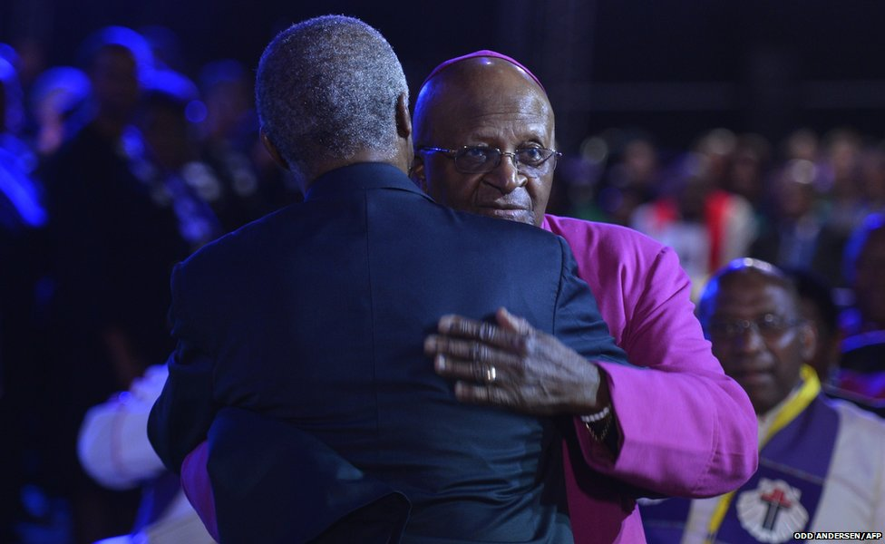 "South Africa""s archbishop emeritus Desmond Tutu (R) and former South African President Thabo Mbeki greet each"