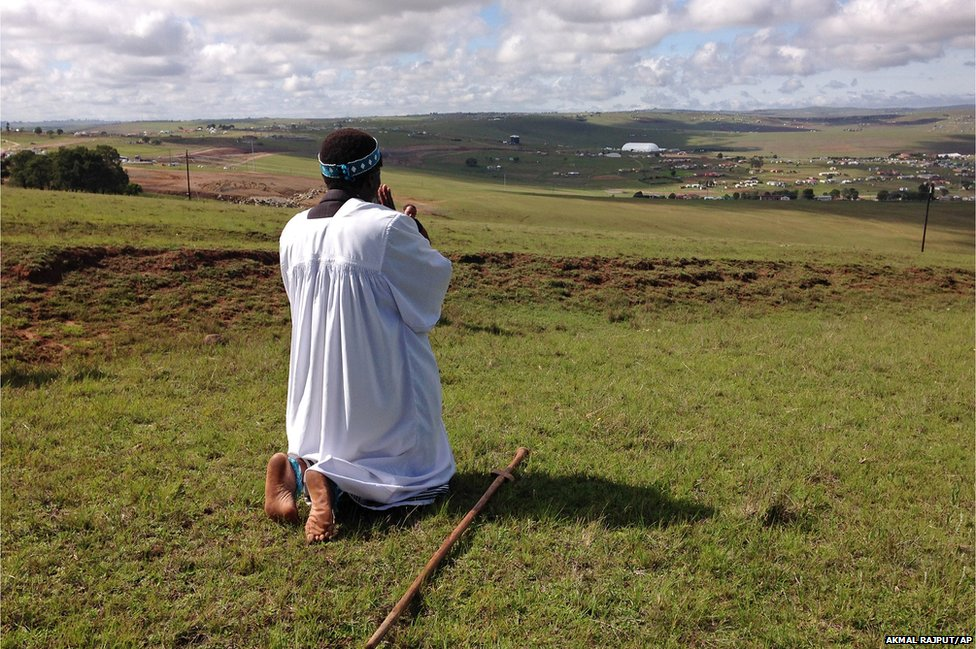 Shembe priest Michael Notychanga prayed in the direction of the home of former Mr Mandela