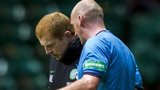 Referee Bobby Madden explains his decision to Celtic boss Neil Lennon