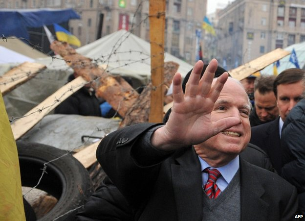 US Senator John McCain greets protesters on Independence Square in Kiev, 15 December