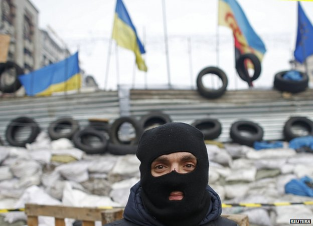 A masked pro-EU protester on Independence Square in Kiev, 15 December