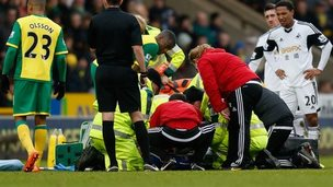 Medics attend to Swansea City's Nathan Dyer