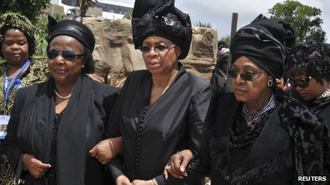 Winnie Mandela (R) and Graca Machel (C) attend Mandela's funeral ceremony in Qunu