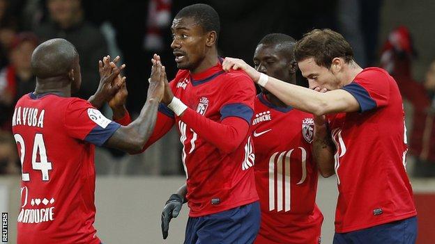 Former Chelsea forward Salomon Kalou celebrates scoring in Ligue 1 for Lille