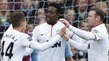 Manchester United's Danny Welbeck (centre) is congratulated by Adnan Janujaz (left) and Wayne Rooney after scoring against Aston Villa