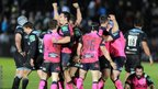 Cardiff Blues' players celebrate their side's 9-7 win over Glasgow Warriors at the end of the game at Scotstoun.