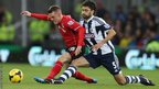 Cardiff's Craig Noone tangles with West Brom midfielder Claudio Yacob during Saturday's Premier League game at Cardiff City Stadium.