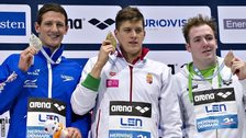 Daniel Gyurta (C) of Hungary poses with his gold medal alongside silver medallist Michael Jamieson (L) of Britain and bronze medallist Marco Koch (R) of Germany during the medal ceremony for the 200m Men