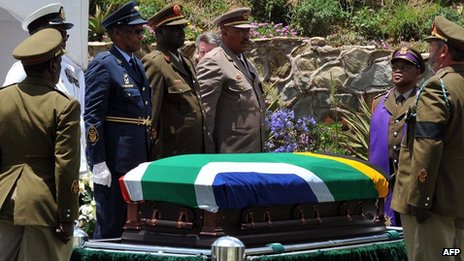 Military personnel surround Nelson Mandela's coffin