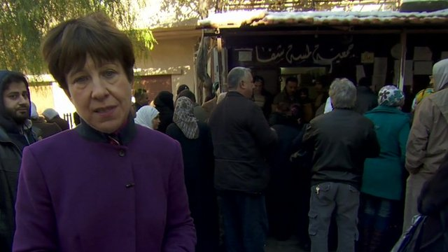 Lyse Doucet with Syrians at a Damascus aid distribution centre